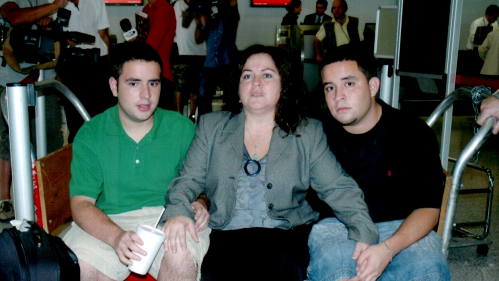 Juan, Alex and their mum Liliana at the Miami Airport minutes before she was deported to Colombia.